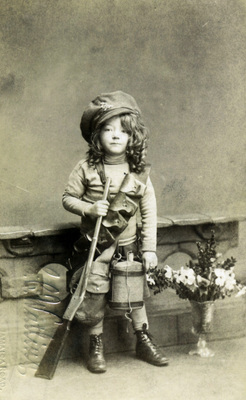 A photographic postcard showing a girl dressed as a British soldier photographed at a photographer's studio in Bermondsey, London  Source: The Army Children Archive