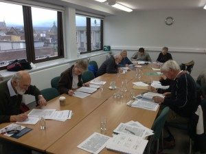 Some of our volunteers examining the Kelly's Directories at the Second Project Workshop